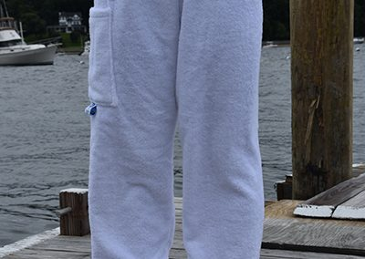 white towel pants worn by girl on dock