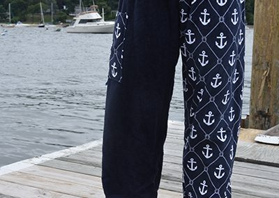 anchor towel pants worn by girl on dock