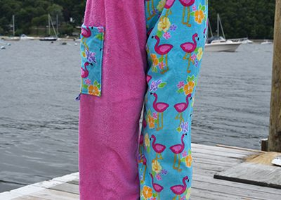 flamingo towel pants girl on dock