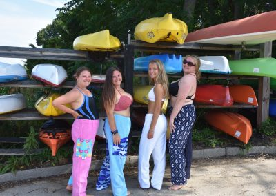 towel pants, 4 girls, by a kayak rack